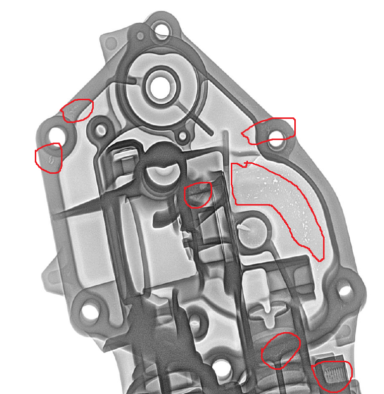 Digital Radiography Image of an Automobile Component. Discontinuities in the component are mark. Shrinkage, Porosity, Internal defects. ASTM E2422, E2973, E155,